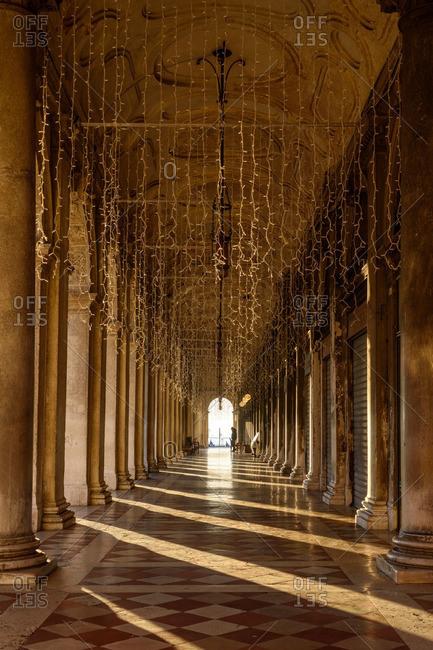A portico in sunlight in Venice