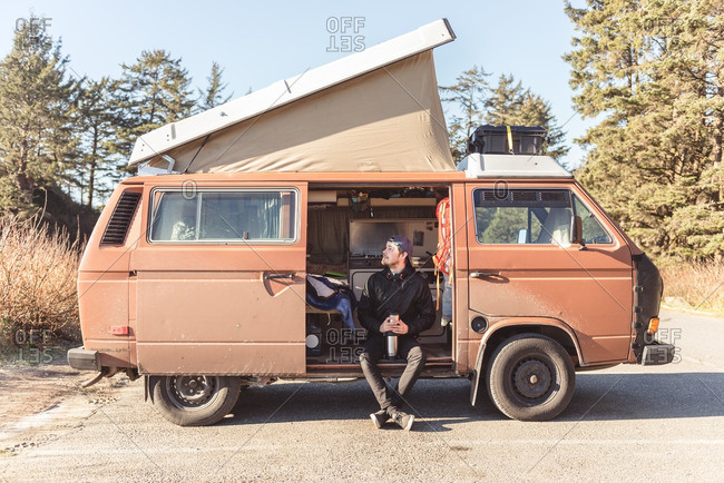 Vancouver Island, British Columbia - January 4, 2017: Man sitting in old camper van