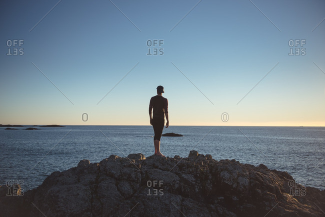Man in coastal sunset, Vancouver Island, Canada