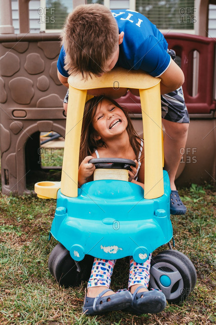 Boy and girl playing with toy car