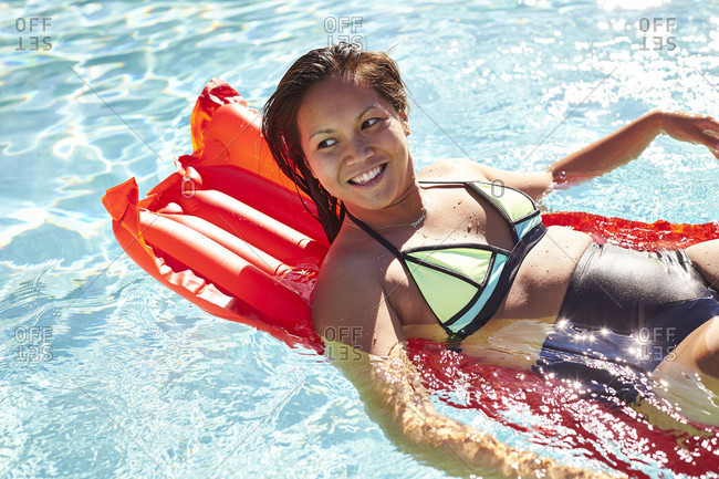 An Young Asian Woman Leaning On Air Bed In Pool
