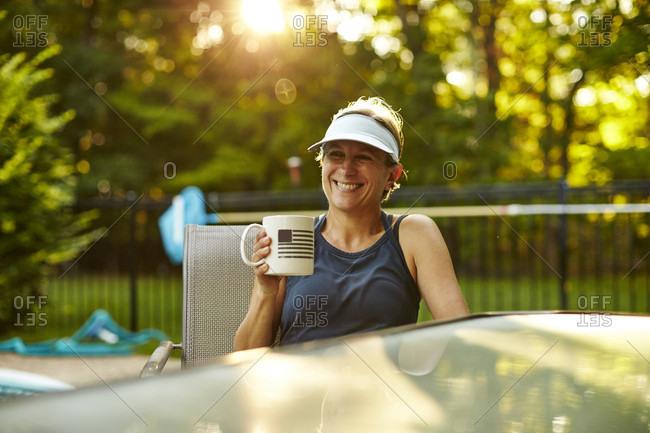 A Woman Enjoys A Coffee After Her Run