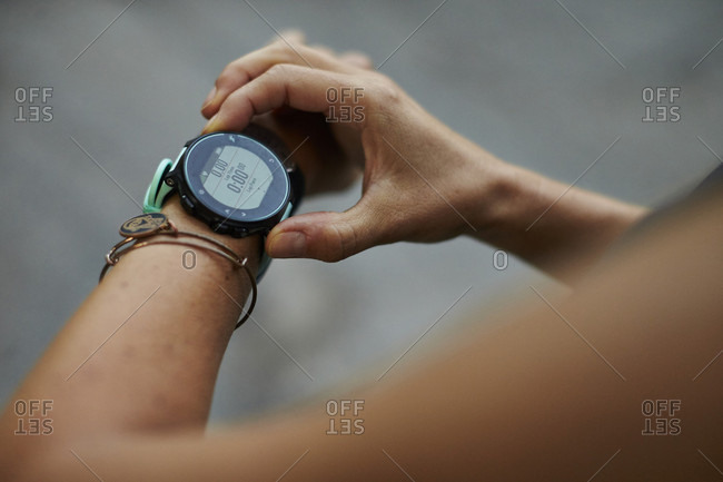 Close-up Of A Runner Starting Her Fitness Watch