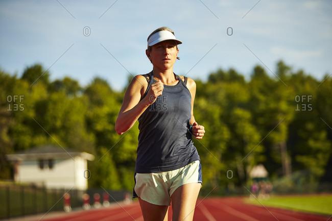 Female Runner Running On Track