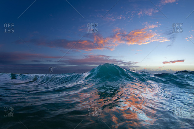 An Ocean Wave In The Early Morning Light On The East Side Of Oahu