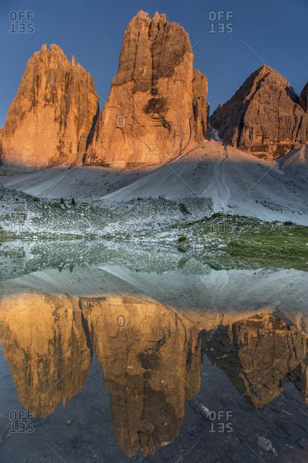 Scenic View Of Tre Cime Di Lavaredo At Dolomites During Sunset