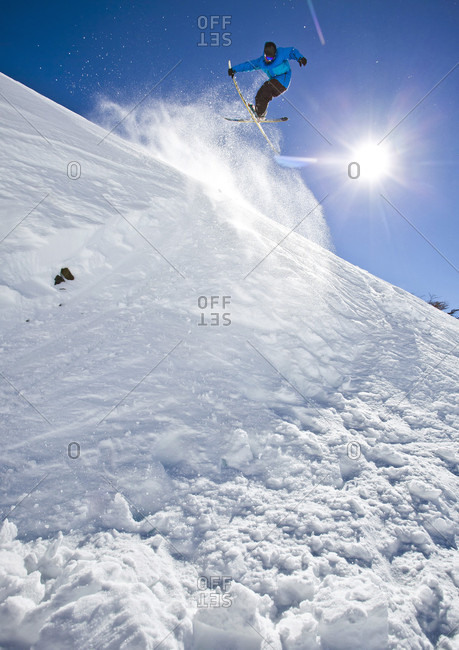 A Skier Hits A Jump And Grabs His Skies While Skiing At Cerro Catedral, Argentina