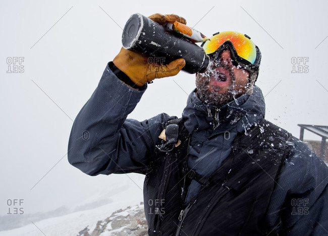 A Man Pours Water On His Face On Windy Ridge At Cerro Catedral In Argentina