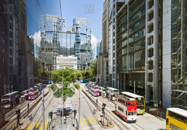 Central, Hong Kong, China - June 15, 2015: Buses Riding On Street In The Business District Of Hong Kong