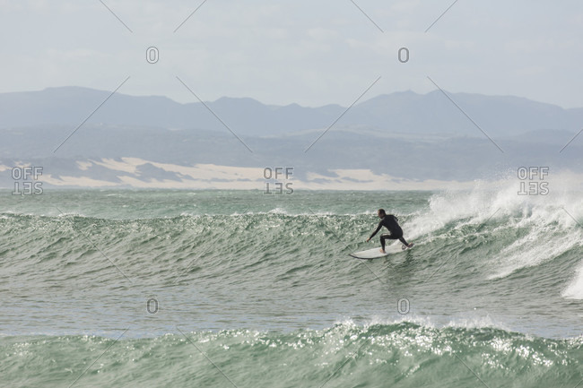 A Male Surfer On A Big Wave At Jeffery's Bay, South Africa