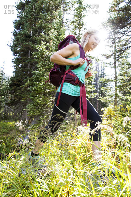 Young Woman Hiking In Rocky Mountain National Park, Colorado