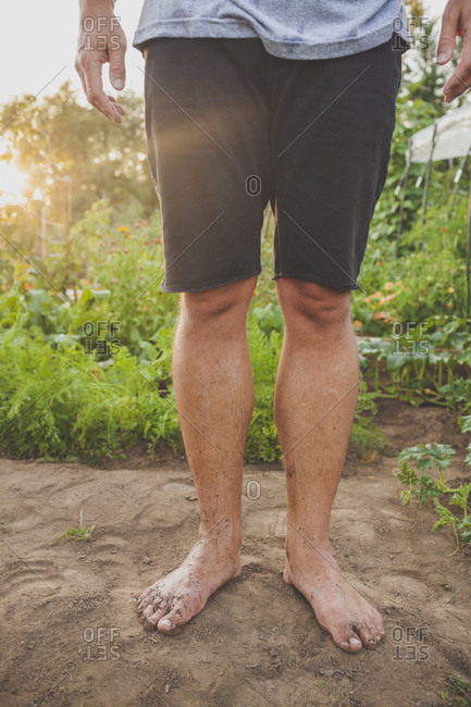 A Man Works Barefoot While Tending To His Garden In Fort Langley