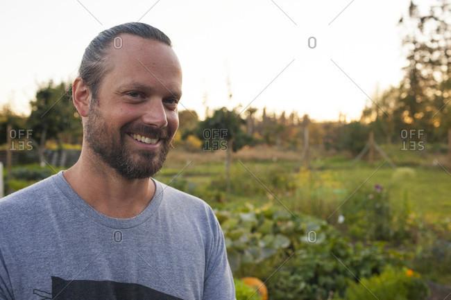 Portrait Of Man Standing In His Garden In Fort Langley