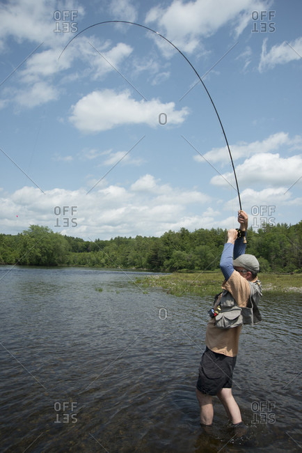 Fisherman Catching Big Brown Trout On The Kennebec River