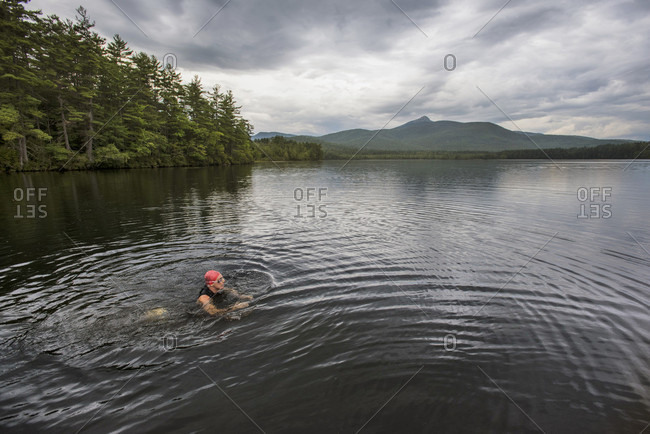 A Swimmer Taking A Break In The Shallow Water On A Cloudy Day