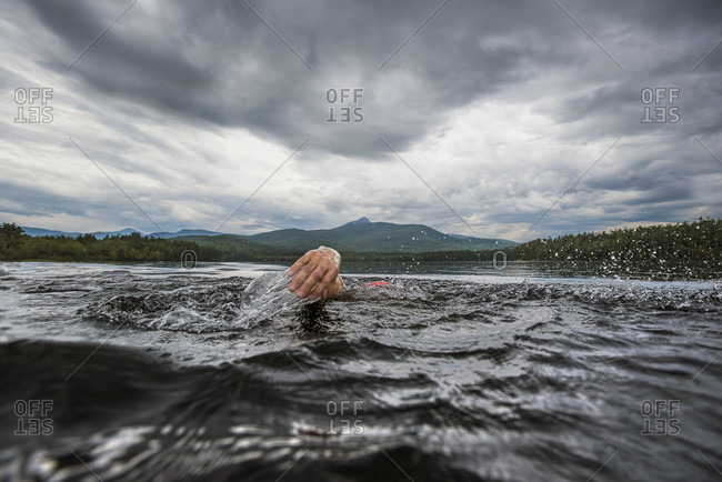 The Hand Of A Swimmer Pulling Out Of The Water While Swimming In Lake