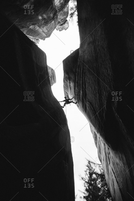 Person Climbing On Sandstone Tower In Adrspach, Czech Republic
