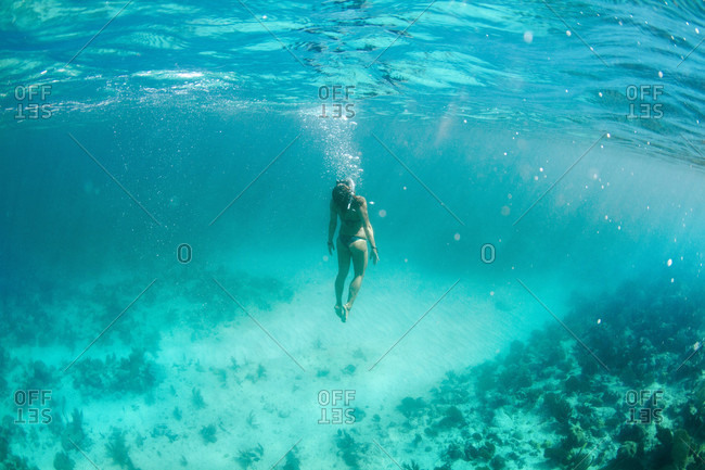 View Of Girl Swimming Underwater In The Coast Of Trinidad, Cuba
