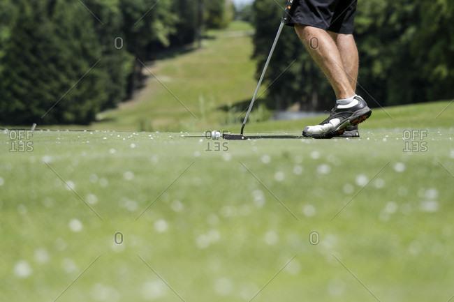 Close-up Of Man's Leg Taking A Shot At A Golf Ball