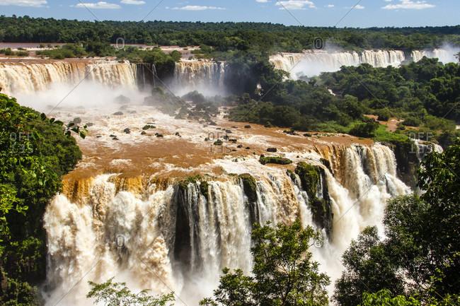 High Angle View Of Muddy Reddish Brown Waters Of Iguazu Falls