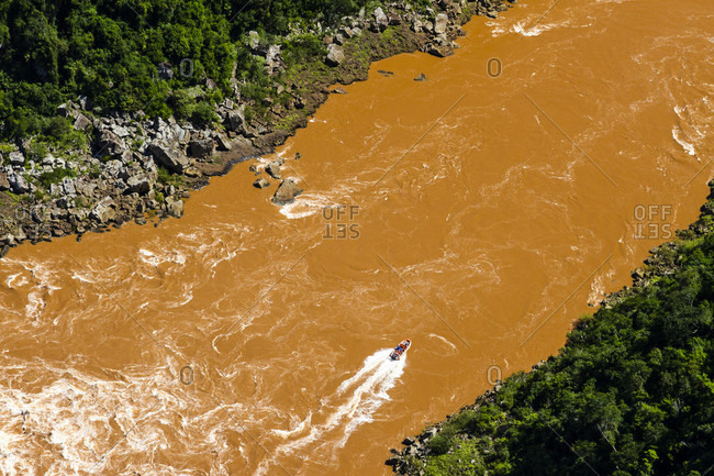 Aerial View Of A Muddy Brownish Red Colored Rio Iguacu River
