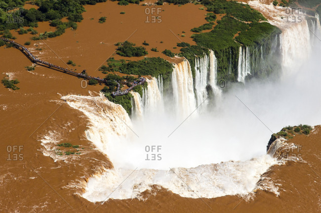An Aerial View Of The Iguazu Falls With Muddy Water