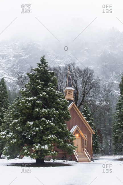 Yosemite Church During Winter With Foggy Mountains In The Background