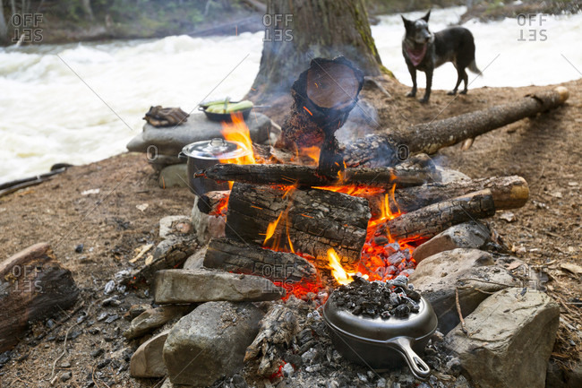 Food Is Prepared In Cast Iron Cooking Vessels Over A Hot Campfire