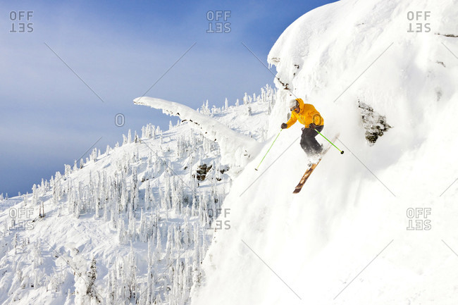 A Male Skier Airs A Cliff At Whitefish Mountain Resort In Whitefish, Montana, Usa