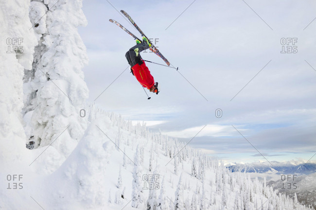 Male Skier Does A Back Flip Off A Backcountry Ski Jump Near Whitefish, Montana