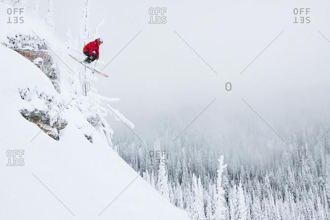 Male Skier Catches Air At Whitefish Mountain Resort In Whitefish, Montana, Usa