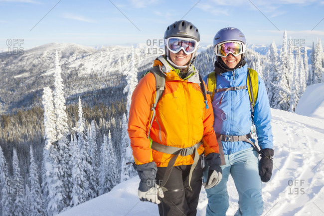Two Female Backcountry Skiers On Snowy Landscape In Northwest Montana