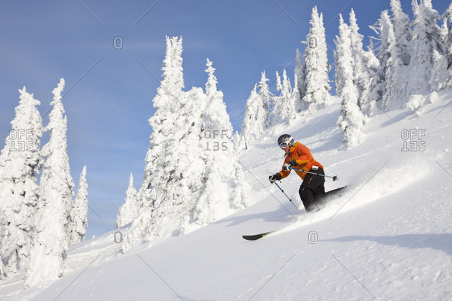 A Fit Female Skier Makes A Turn In Fresh Powder At Whitefish Mountain Resort In Whitefish, Montana