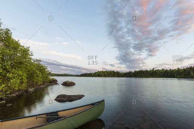 A Canoe On The Shore Of Long Pond In Maine's North Woods