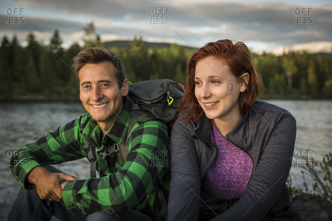 A Young Couple Next To Long Pond In Maine's North Woods Near Greenville, Maine