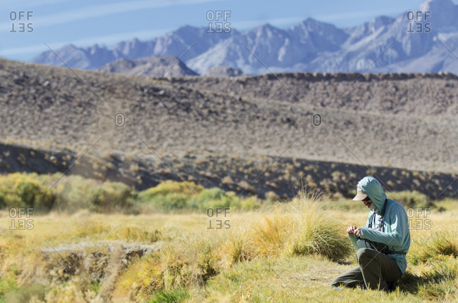 Fisherman Prepares His Fly Before Fly Fishing On The Owens River, Bishop, California