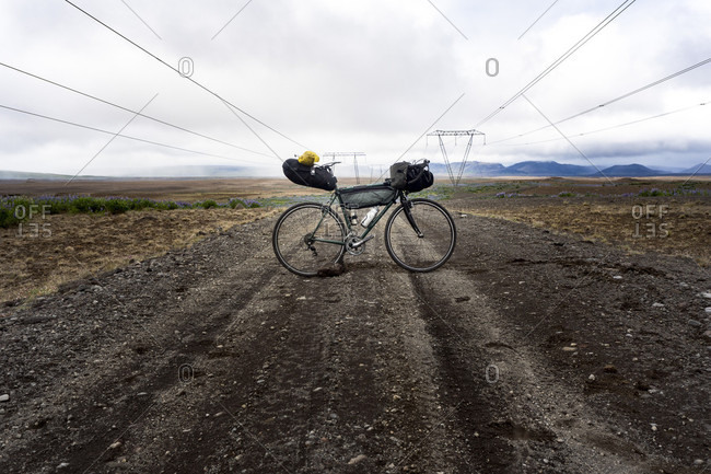Mountain Bike Standing On The Dirt Road In Sandvatn, Iceland