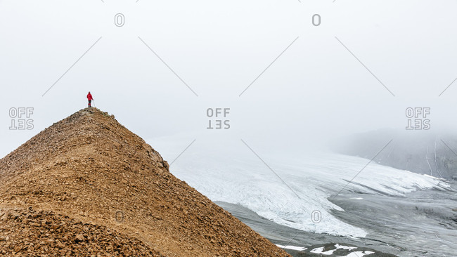 Distant View Of Female Hiker Exploring Glacier In The Delta Mountains