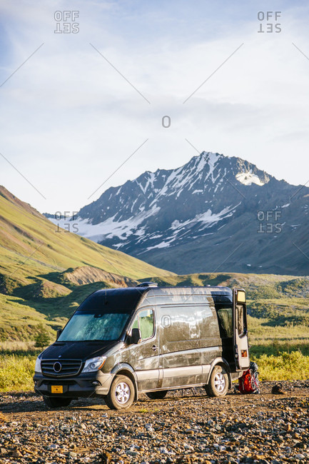 A Mercedes Sprinter Van Is Parked Off Road In Alaska, Usa
