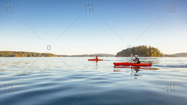 A Woman And A Boy Are Kayaking In Deer Harbor, Orcas Island, Washington, Usa