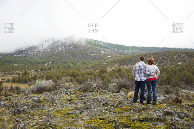 Engaged Couple Exploring The Scenic View Of Private Farm In Klamath Falls, Oregon, Usa