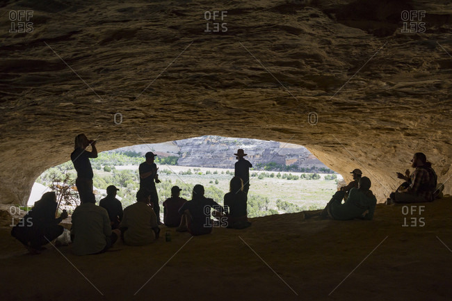 Group Of Rafters Relaxing In The Cave Of The Dinosaur National Monument