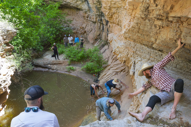 Group Of Rafters Climbing The Rocky Slope Near Yampa And Green River