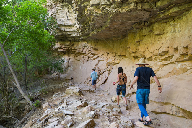 Three Rafter Walking On Rocky Landscape Of Yampa And Green Rivers Through Dinosaur National Monument