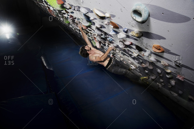 Male Athlete Climbing On Indoor Climbing Wall