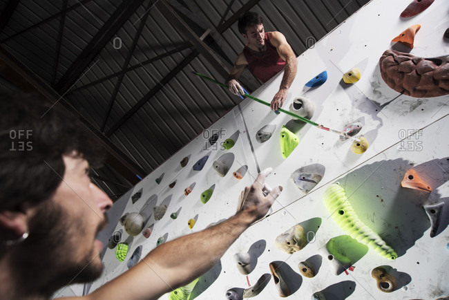 Couple Of Friends Training At Indoor Climbing Centre