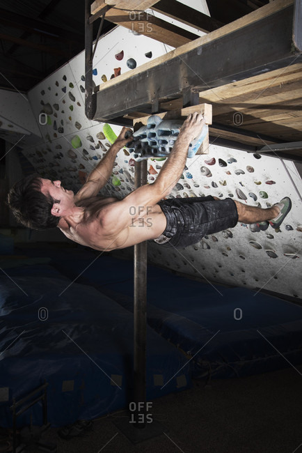 Male Climber Doing Pull Ups Near Indoor Climbing Centre