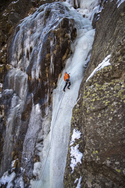 Man Ice Climbing In Simplonpass, Switzerland