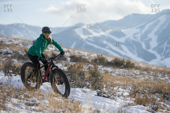 A Woman Fat Biking On The Trails Above Park City, Utah
