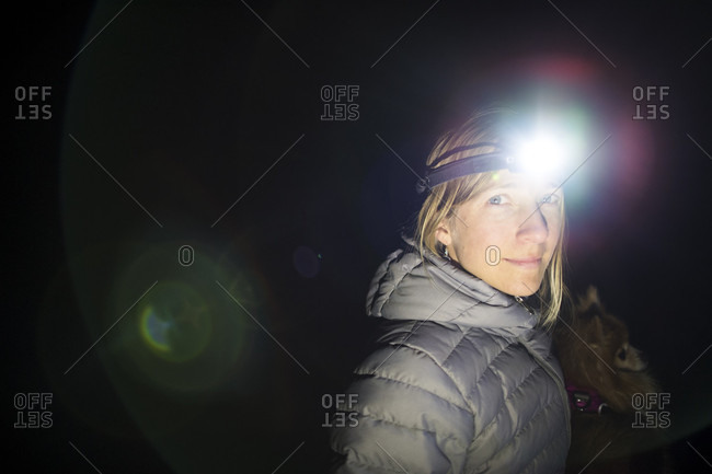 Portrait Of A Woman With A Headlamp